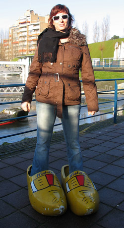 Mel in oversized clogs