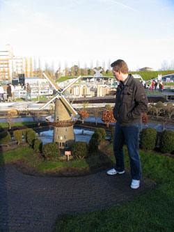 Alex next to a minature windmill